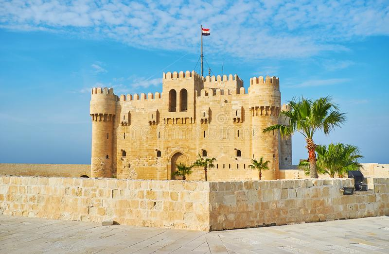 The fort of Alexandria, Egypt. The view on Qaitbay castle from the tall defensive wall of fort, Alexandria, Egypt stock photography
