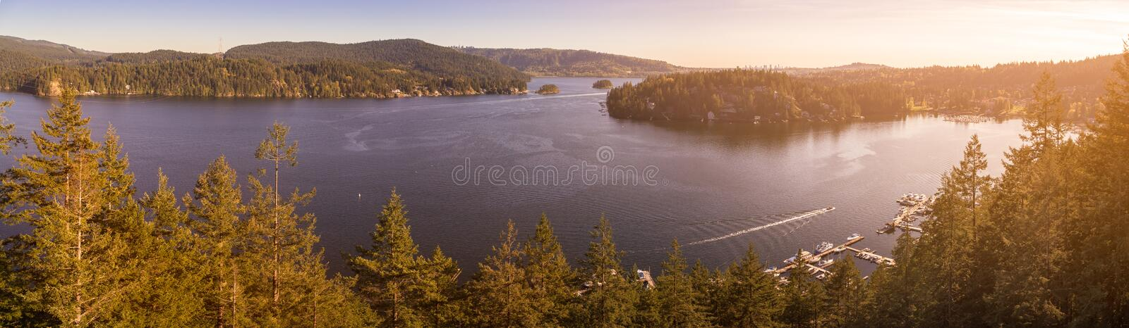 A view from Quarry Rock near Deep Cove with a sun-burst. A view from Quarry Rock near Deep Cove with a sun-burst stock photo