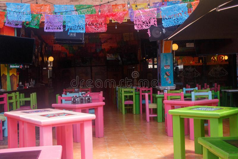 View of a quiet and colorful terrace in Playa del Carmen beach, Mexico. View of a quiet terrace and colorful in Playa del Carmen beach, Street zone, Mexico royalty free stock photo