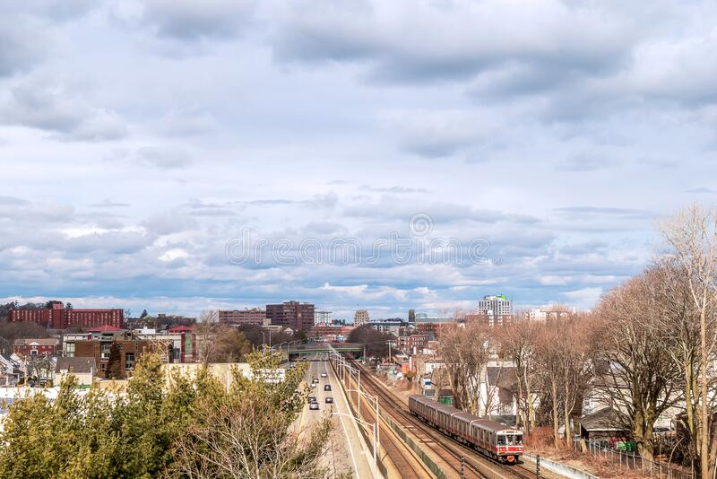 View of railway tracks, trains and downtown in the distance stock photos
