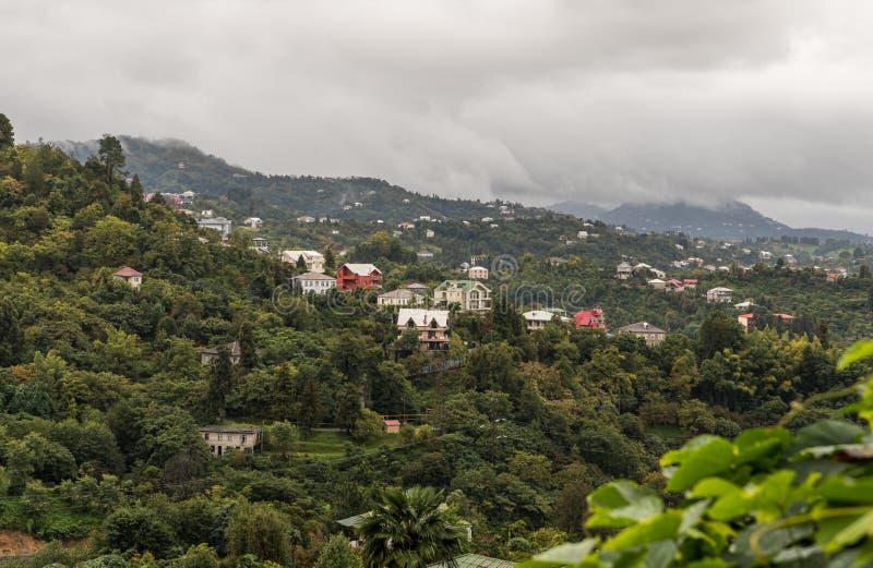View on a rainy day from the Batumi Botanical Garden on nearby mountains in Georgia stock photos