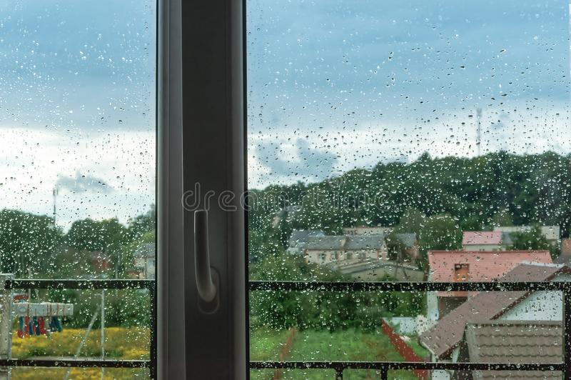 The view of rainy weather, inclement weather outside the window. Inclement weather outside the window, the view of rainy weather royalty free stock image
