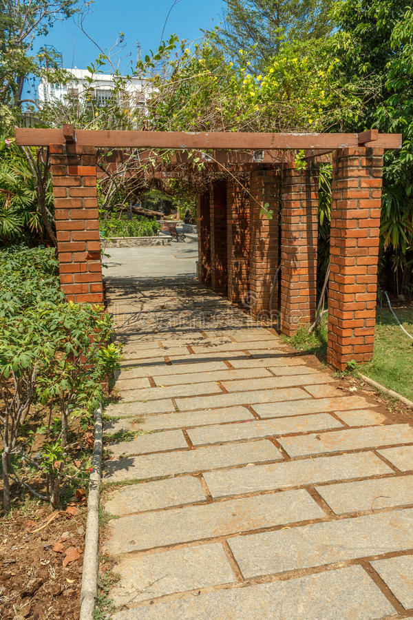 Download View Of Red Brick Pillar Pathway In A Garden, Chennai, India, April