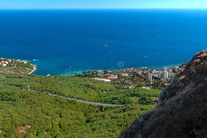 View from the Red Cliff on the town of Foros to coast of the Black Sea. Crimea. View from the Red Cliff  on the town of Foros to coast of the Black Sea. Crimean royalty free stock images