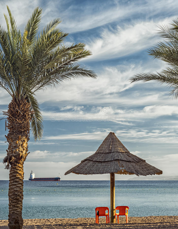 View on the Red sea from Eilat. Sandy beach of Eilat - famous resort and recreation city of Israel royalty free stock photo