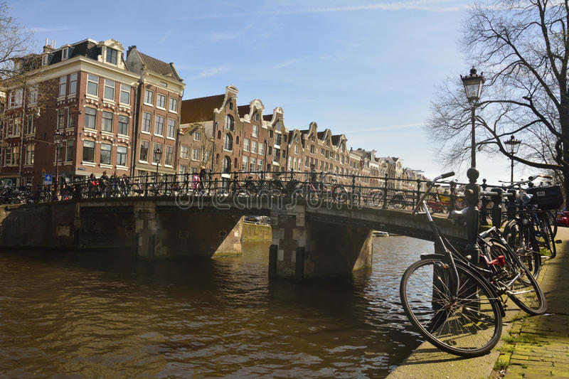 View of Reestraat bridge spanning Prinsengracht canal in Amsterdam royalty free stock images