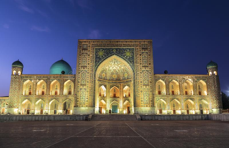View of Registan square in Samarkand - the main square with Ulugbek madrasah at sunset stock photos