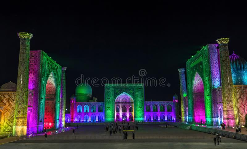 View of Registan square in Samarkand with Ulugbek madrassas, Sherdor madrassas and Tillya-Kari madrassas at night during the color royalty free stock images