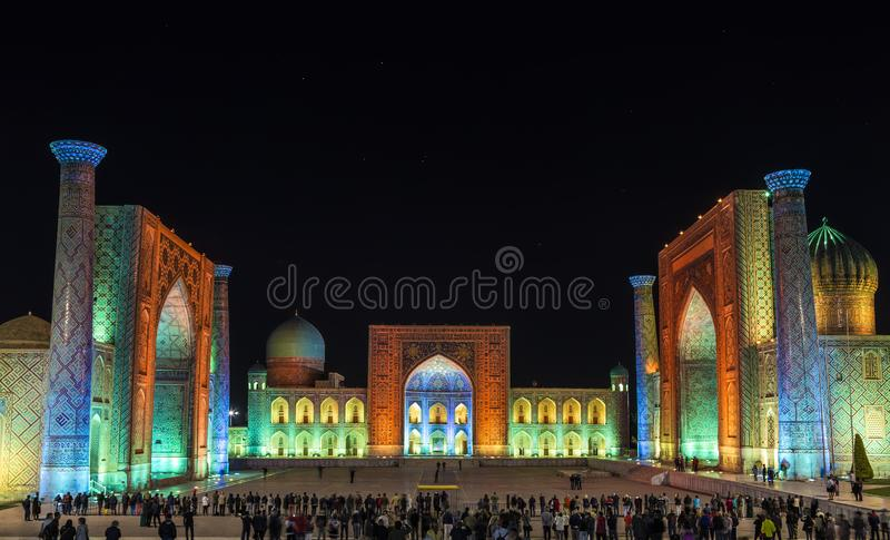 View of Registan square in Samarkand from Ulugbek madrassas, Sherdor madrassas and Tillya-Kari madrassas at night with multi-color royalty free stock photo