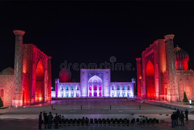View of Registan square in Samarkand with Ulugbek madrassas, Sherdor madrassas and Tillya-Kari madrassas at night with red backlig royalty free stock image