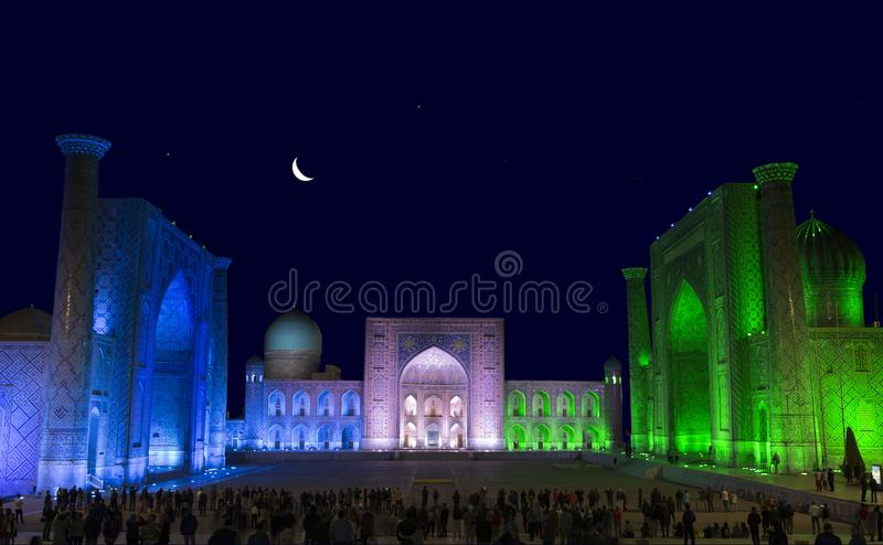 View of Registan square in Samarkand from Ulugbek madrassas, Sherdor madrassas and Tillya-Kari madrassas at night with multi-color stock images
