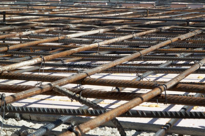 View of reinforcement of concrete with metal rods connected by w. Ire. Preparation for pouring the Foundation, construction, building, steel, precast, house royalty free stock images