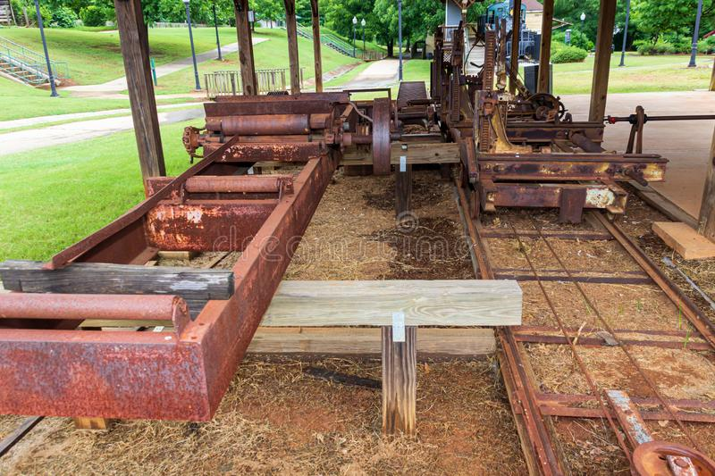 A view of replicas of components of the saw mill at Miller`s Mill in McDonough, GA. McDonough, Georgia / USA - June 9, 2019: A view of replicas of components of stock image