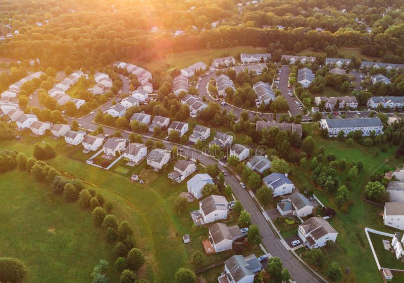 View of the residential area over the roofs of homes early sunrise stock photos