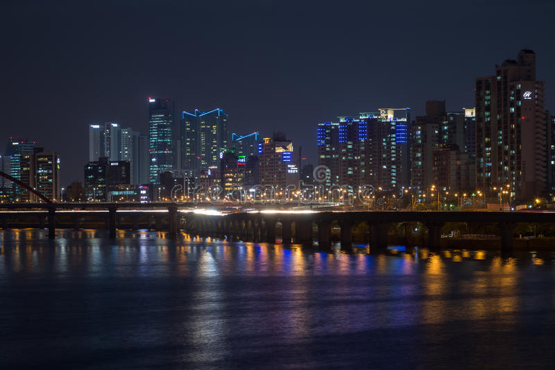 View of a residential district in Seoul at night. Lit residential district along the Han River in Seoul, South Korea, at night stock images