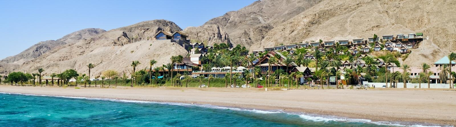 View on resort hotels in Eilat, Israel. Eilat is a famous city with beautiful beaches and resort hotels packed with thousands of vacationers and relaxing stock images