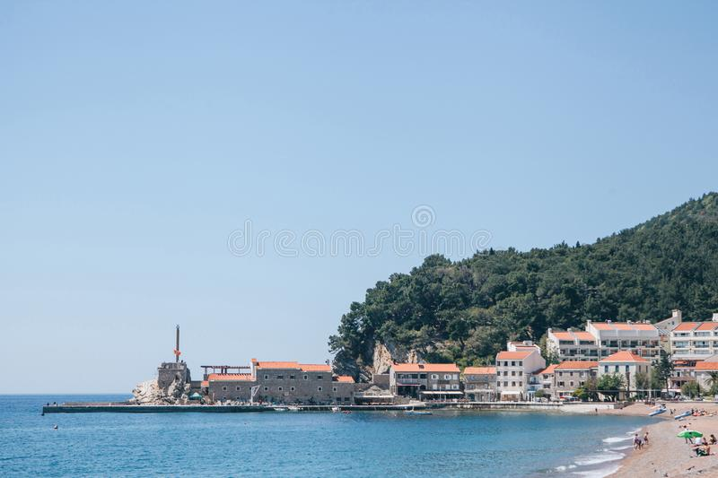 View of the resort town of Petrovac. Beautiful view of the coastal resort town of Petrovac in Montenegro with the old fort and buildings and the beach royalty free stock photos