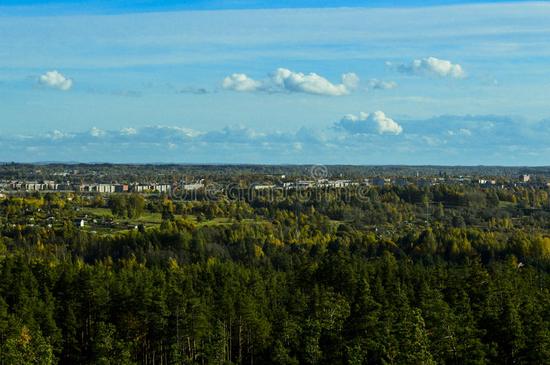 View of Rezekne. View of Rezekne, Latvia, from a viewing tower in the forest on Anchupani mountains in the sunny autumn afternoon royalty free stock image