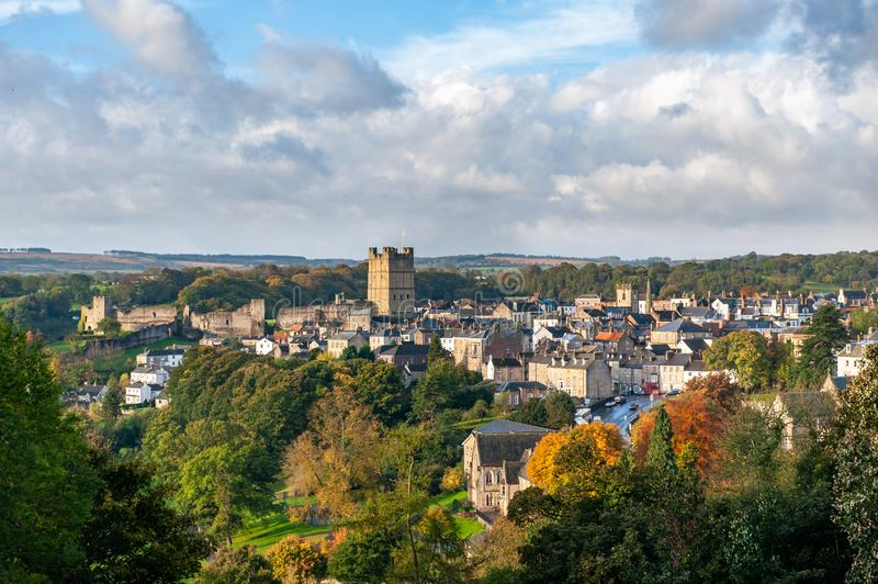 View of Richmond Castle, North Yorkshire with the town in the foreground and autumn colours.  royalty free stock photo