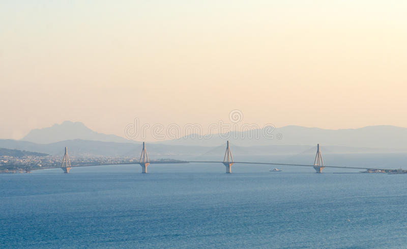 View on Rio-Antirrio bridge at sunset and deep blue water of Ion. Ian Sea in Corinth gulf, Greece royalty free stock photos