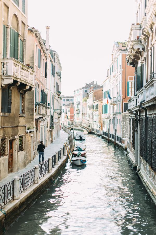 View of the Rio Marin Canal with boats and gondolas from the Ponte de la Bergami in Venice, Italy. Venice is a popular tourist des royalty free stock image
