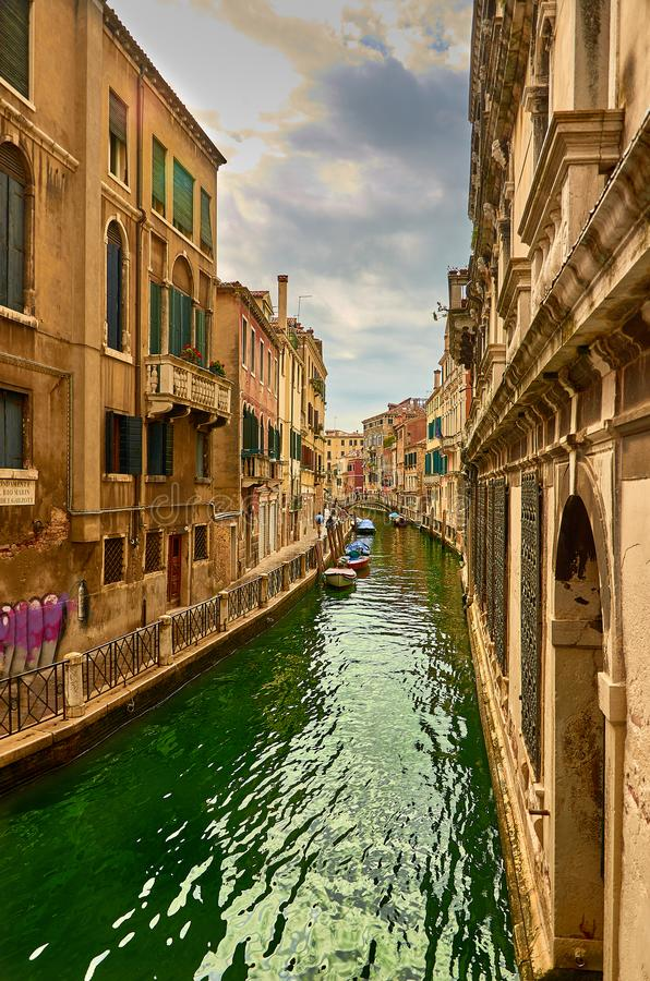 View of the Rio Marin Canal with boats and gondolas from the Ponte de la Bergami in Venice, Italy. Venice is a popular royalty free stock images