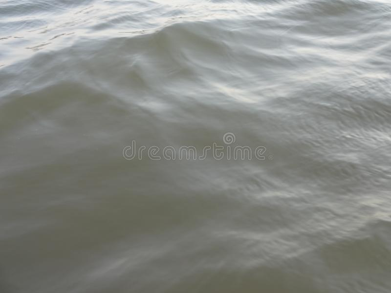 View of ripples and wave in the river water stock image