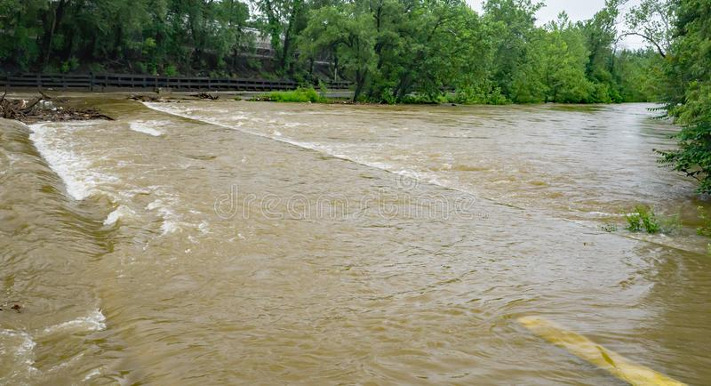 Flood Waters Covering Bridge – May 18th, 2018. A view of the rising flood waters over bridge on Wiley Drive located in Smith Park, Roanoke, Virginia, USA royalty free stock photo