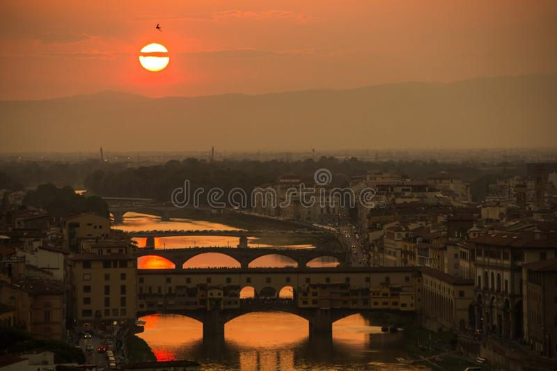 View of the River Arno and famous bridge Ponte Vecchio. Amazing evening golden hour light. Beautiful gold sunset in Florence. View of the River Arno and famous stock image
