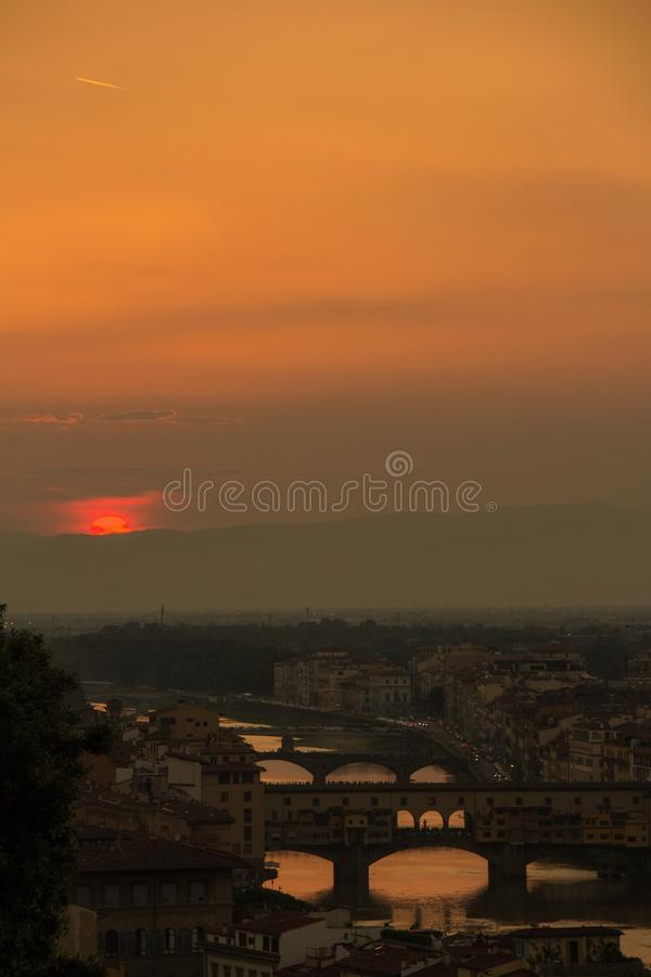 View of the River Arno and famous bridge Ponte Vecchio. Amazing evening golden hour light. Beautiful gold sunset in Florence. View of the River Arno and famous royalty free stock photography