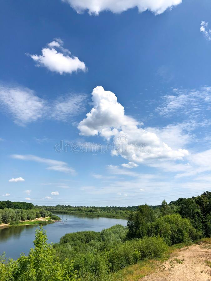 View of the river and the blue sky with clouds from the railway bridge.  royalty free stock photos