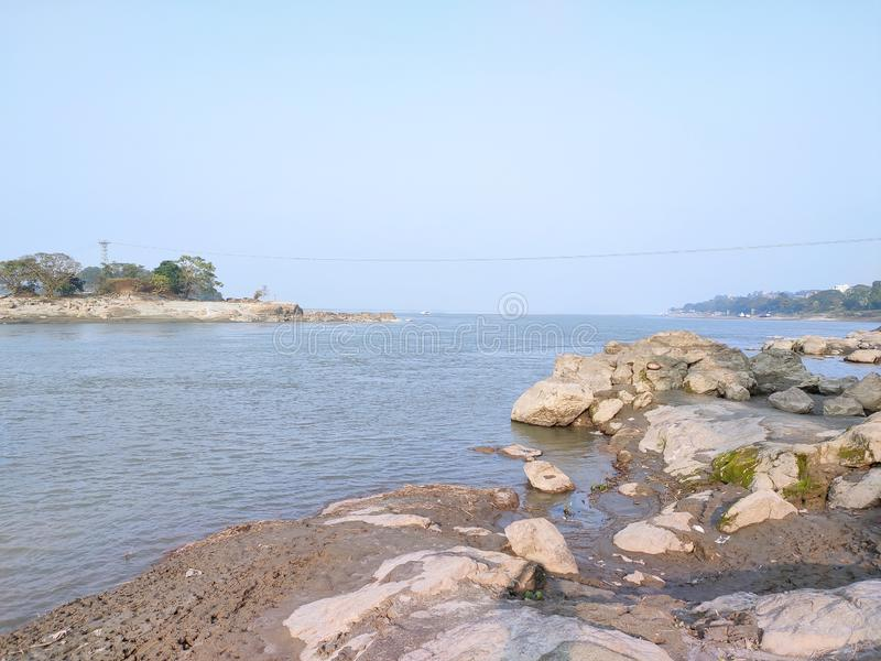 View of river Brahmaputra with rocky bank at Guwahati, Assam, India royalty free stock images