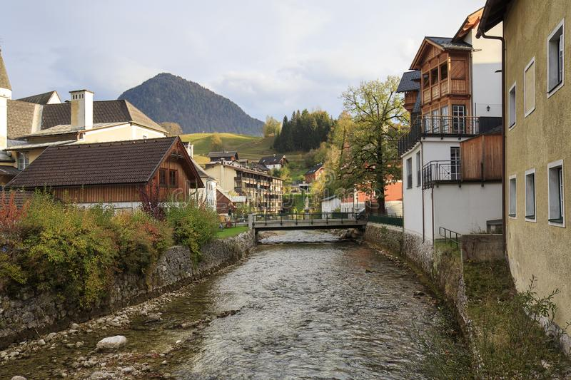View of the river flowing through the town of Bad Aussee. Autumn alpine landscape. Bad Aussee, Austria stock photos
