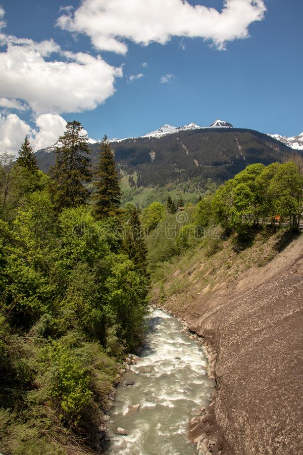 View of a river with high mountains in the background in the Swiss Alps stock image
