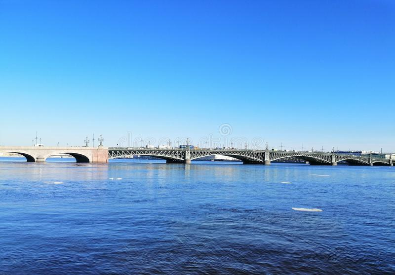 View of the river with ice and bridge stock images
