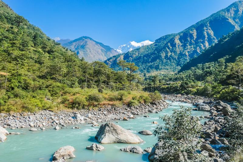 Nepal - View on the River and Mountains from Bhulbhule. View on River and Mountains from Bhulbhule, Annapurna Circuit Trek, Nepal. Turquoise color of the river stock photography
