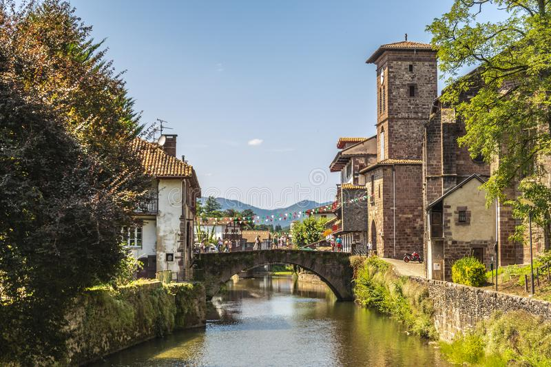 View of the river Nive on its way through the village of Saint Jean Pied de Port. France. stock images