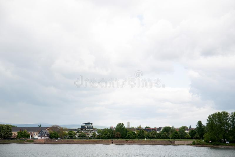 View on a riverbank under a cloudy sky in mainz germany. And photographed on a sightseeing tour at a cloudy day stock photos