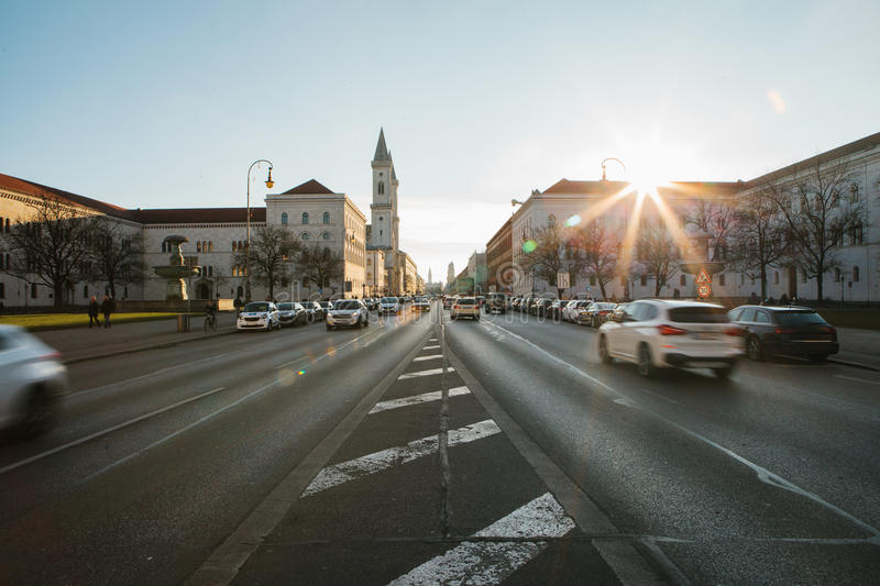 View of the road on the street Leopoldstrasse in Munich - the capital of Bavaria in Germany. Fast blurred motion car on stock image