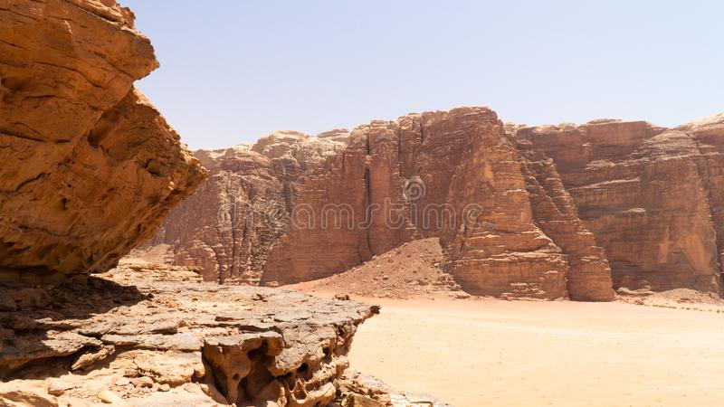 View of rock formations and mountains in the middle of Wadi Rum desert, Jordan. View of rock formations and mountains in the middle of Wadi Rum desert, located royalty free stock photos