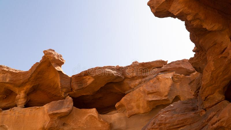 View of rock formations and mountains in the middle of Wadi Rum desert, Jordan. View of rock formations and mountains in the middle of Wadi Rum desert, located stock images