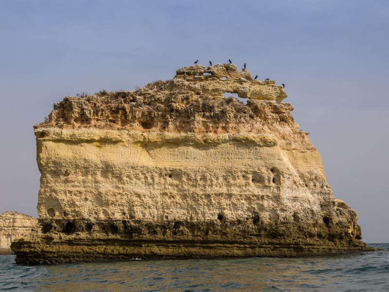 View of a rock islet on Marinha beach from a boat Algarve, Portugal stock photo