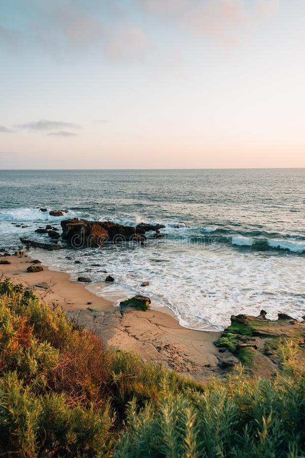 View of a rocky beach at sunset, in Laguna Beach, Orange County, California.  stock images