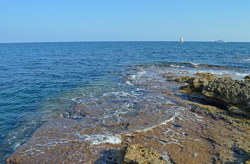 A View From A Rocky Shore - Sea side Rocks Reef royalty free stock image