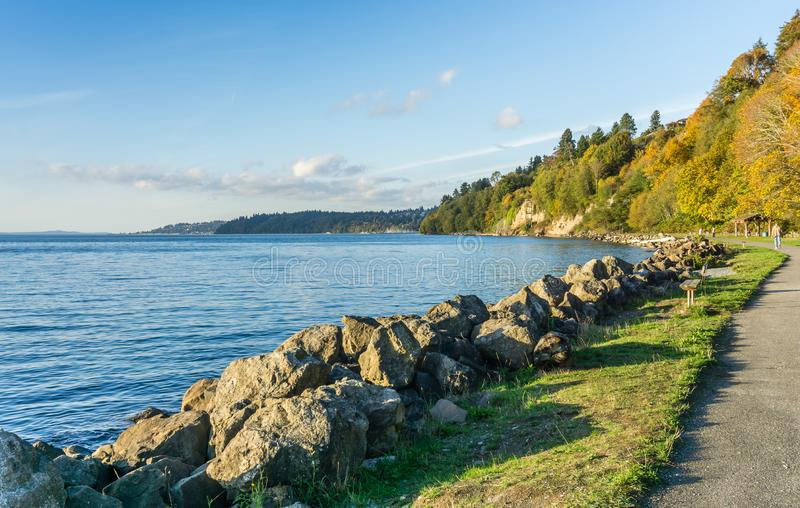 Rocky Autumn Shoreline 2. A view of the rocky shoreline at Saltwater State Park in the autumn royalty free stock photos