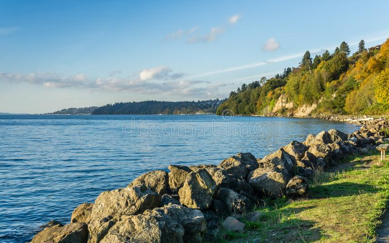 Rocky Autumn Shoreline. A view of the rocky shoreline at Saltwater State Park in the autumn stock photo