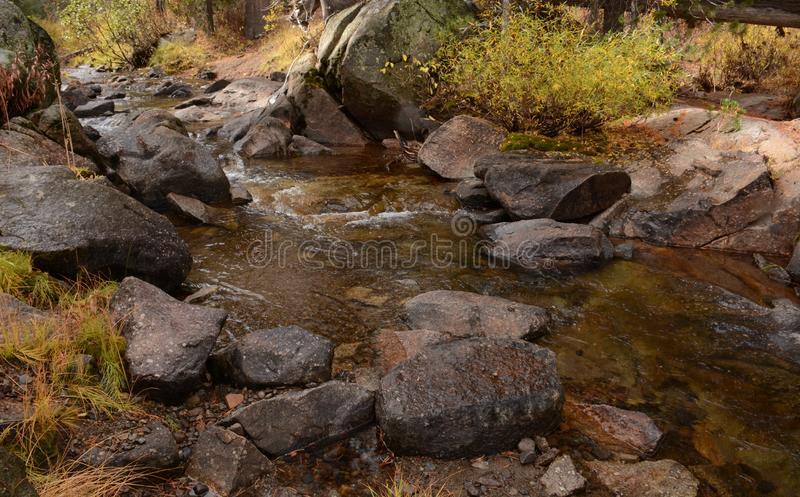 A Rocky Stream in Hope Valley. A view of a rocky stream flowing through Hope Valley in California royalty free stock images