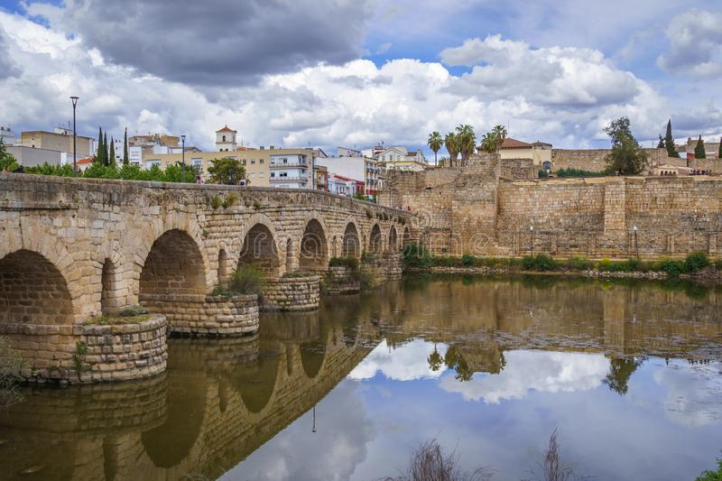 View of the Roman bridge of Merida with its reflection on the Guadiana river. stock images