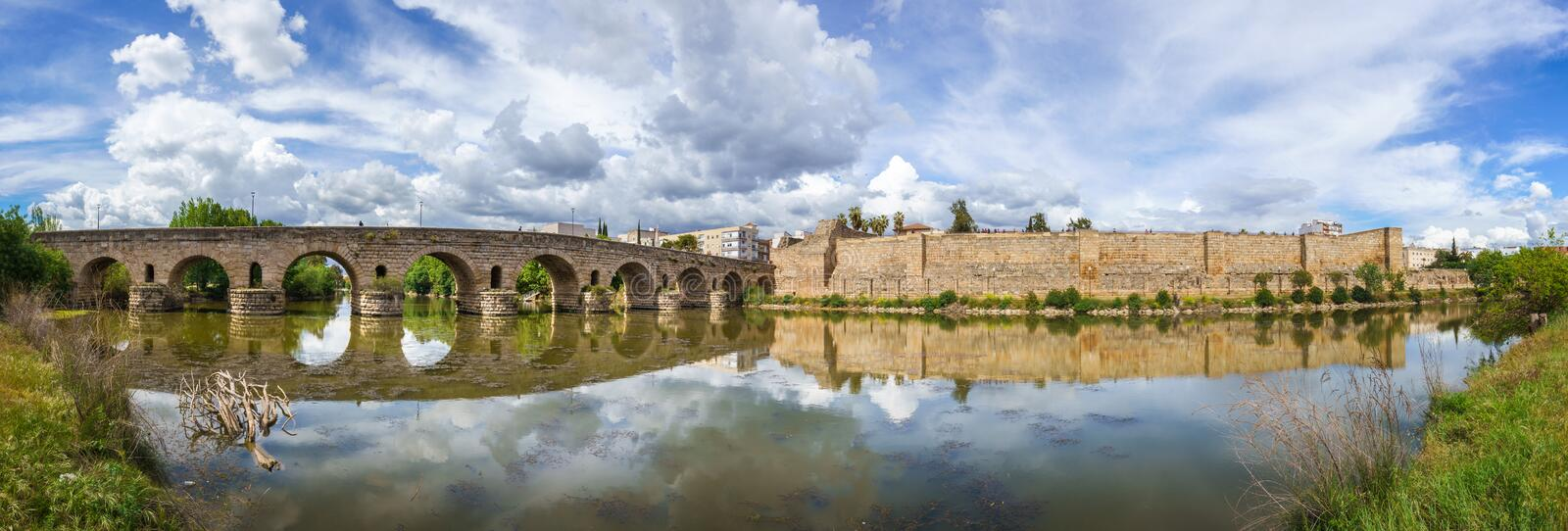 View of the Roman bridge of Merida with its reflection on the Guadiana river. royalty free stock photo