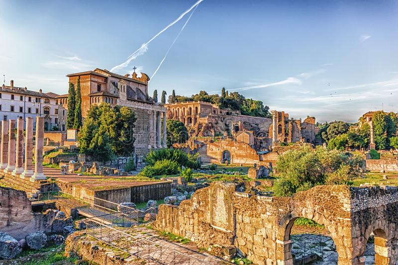 View on the Roman Forum, Tiberius Palace and the Temple of Antoninus and Faustina from the Basilica Aemilia ruins royalty free stock image